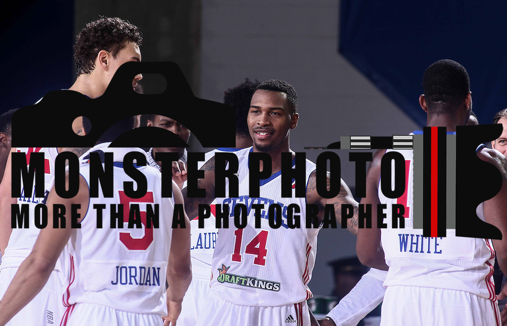 Delaware 87ers Guard SEAN KILPATRICK (14) celebrates with his teammates in the final seconds of the fourth period during a NBA D-league regular season basketball game between the Delaware 87ers (76ers) and the Canton Charge (Cleveland Cavaliers) Tuesday, Nov. 17, 2015, at The Bob Carpenter Sports Convocation Center in Newark, DEL