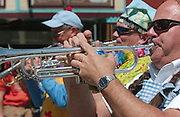 Horn players from the Scottville Clown Band from Scottville, Michigan perform during the Memorial Weekend Grand Parade in Mackinaw City, Michigan.