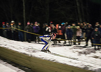 Chris Ebner of Plymouth heads down the inrun during the High School Jump Meet held at Plymouth High School Friday evening. (Karen Bobotas/for the Laconia Daily Sun)