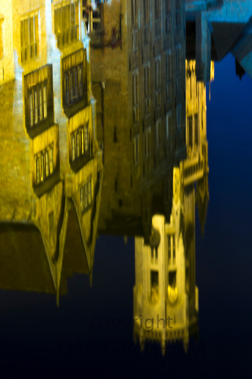 Famous picturesque scene canal buildings and belfry reflected in canal water at the Rozenhoedkaai in Bruges, Belgium