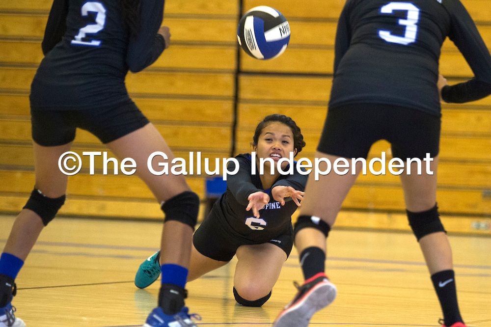 Navajo Pine Warrior Pearly Artieda (6) digs for the ball in the home game against Newcomb Tuesday.