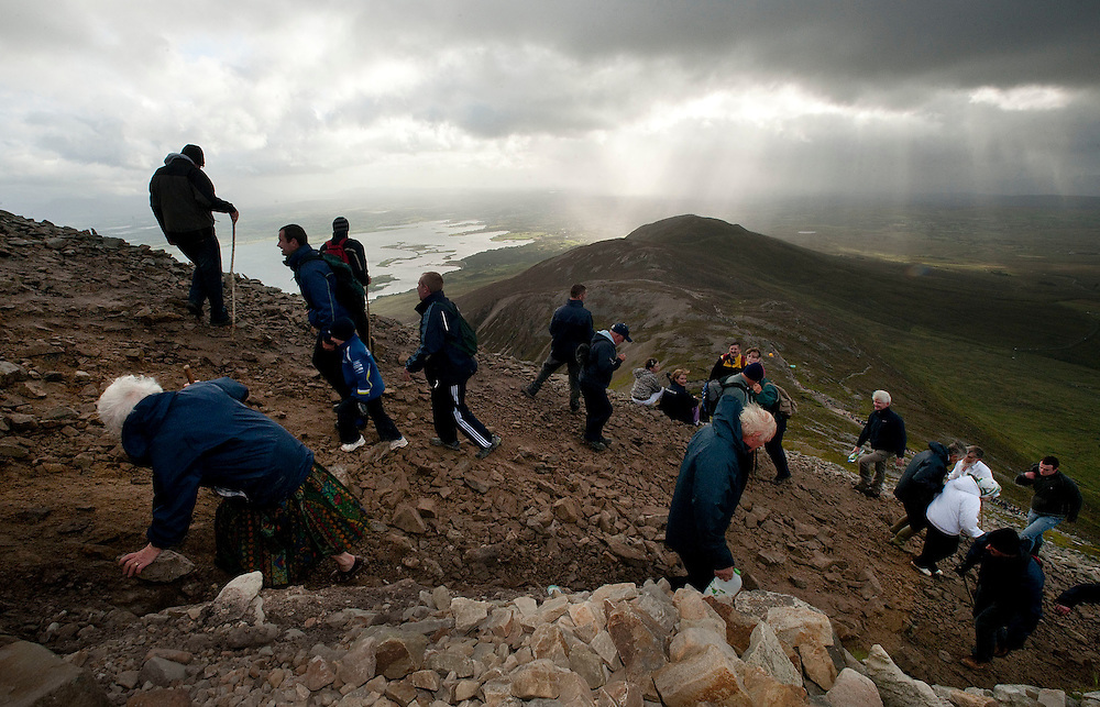 Pilgrims go up and down croagh Patrick on the annual pilgrimage in honour of St. Patrick. Croagh Patrick, Co. Mayo. Pic: Michael Mc Laughlin Thousands of pilgrims navigate up and down the rugged slopes of croagh Patrick in honour of our Patron Saint, Saint Patrick, Ireland's Holy Mountain, Co. Mayo. Pic: Michael Mc Laughlin