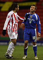 "Photo: Paul Thomas.<br /> Stoke City v Cardiff City. Coca Cola Championship. 28/11/2006.<br /> <br /> Darel Russell (L) of Stoke tells Cardiff's Stephen McPhail to ""leave it"" and just head back to the dressing room after being sent off."