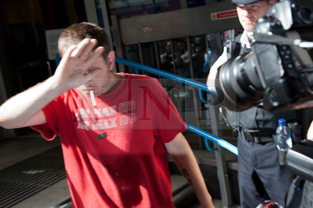 © Licensed to London News Pictures. 11/08/2011. LONDON, UK. David O'Neill, leaves court after hiding from media inside Westminster Magistrates Court. He was given bail after allegedly throwing missiles at police during the London Riots. Photo credit: Matt Cetti-Roberts/LNP