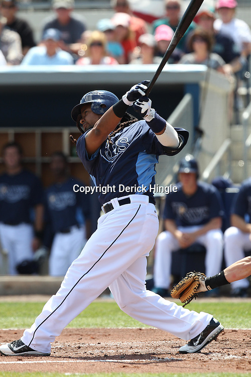 March 15, 2011; Port Charlotte, FL, USA; Tampa Bay Rays designated hitter Manny Ramirez (24) hits a homerun during a spring training exhibition game against the Florida Marlins at Charlotte Sports Park.   Mandatory Credit: Derick E. Hingle