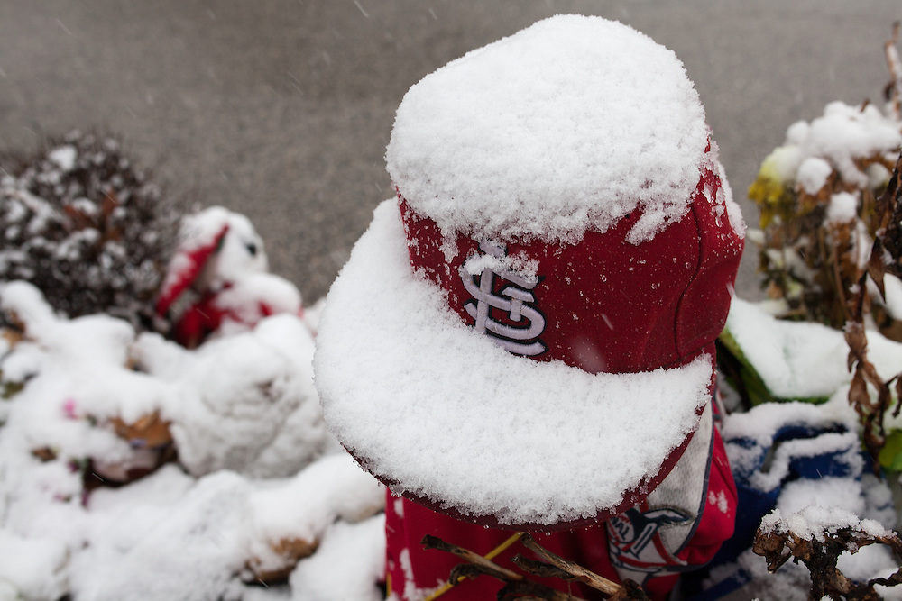 A snow-covered Cardinals hat at the Mike Brown memorial in Ferguson.
