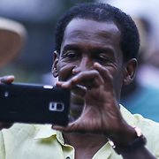 A spectator takes photos of performances during the 27th DuPont Clifford Brown Jazz Festival Saturday, June 20, 2015, at Rodney Square in Wilmington, Delaware.