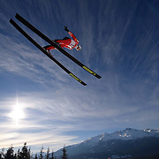 FIS World Cup Ski Jumping at Whistler Olympic Park in Whistler, British Columbia.  The site will be hosting the Olympic nordic events during the 2010 Vancouver winter games.  A ski Jumper soars thru the air during the first round of qualifications.