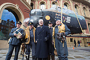 UNITED KINGDOM, London: 26 February 2018 <br /> Sir Barnes Wallis' grandson Jonathan Stopes-Roe (centre) stands among WWII re-enactors in front of a 23 foot Lancaster Bomber replica in front of The Royal Albert Hall this morning to mark the 75th anniversary since 'Operation Chastise' was given final approval. It also comes before a gala screening of The Dam Busters which will be shown in May to make the occasion.<br /> Photograph: Rick Findler