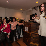 WASHINGTON,DC - MAR20: Leigh Anne Arnold, an alumna of the class of 2010 at Sweet Briar College announces that they have raised $1100 at a pop-up fundraiser, at Mission in Dupont Circle, to save the womens' college in Virginia, which will close if it can't raise $250 million dollars, March 20, 2015. (Photo by Evelyn Hockstein/For The Washington Post)