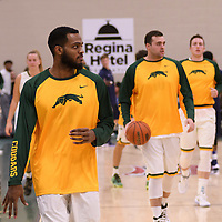 4th year forward Brian Ofori (11) of the Regina Cougars warms up the home opener  on November  4 at Centre for Kinesiology, Health and Sport. Credit: /Arthur Images