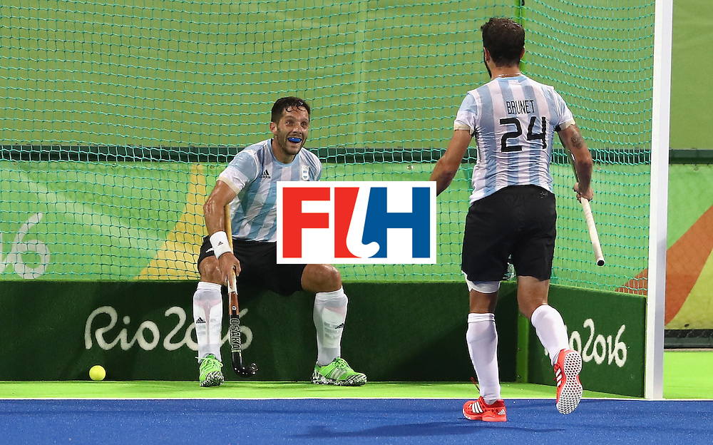 RIO DE JANEIRO, BRAZIL - AUGUST 18:  Agustin Mazzilli (L) of Argentina celebrates with team mate Manuel Brunet after scoring their fourth goal during the Men's Gold Medal match between Argentina and Belgium on Day 13 of the Rio 2016 Olympic Games held at the Olympic Hockey Centre on August 18, 2016 in Rio de Janeiro, Brazil.  (Photo by David Rogers/Getty Images)