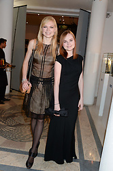 Left to right, sisters KATIA ELIZAROVA and ALISA ELIZAROVA  at the Macmillan De'Longhi Art Auction 2013 held at the Royal College of Art, London on 23rd September 2013.
