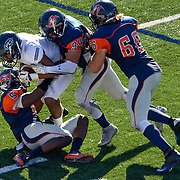 song_sat_0979- Orange Coast College players Semaj Bilal (#5), Daniel Garcia (#94), and Louis Condevaux (#66) team up to tackle Fullerton College's Anthony Wood. November 5th, 2016 — Fullerton College vs Orange Coast College — Men's Football — Costa Mesa, CA<br /> <br /> Photo by Austin Song / Sports Shooter Academy 13