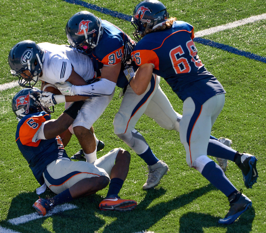 song_sat_0979- Orange Coast College players Semaj Bilal (#5), Daniel Garcia (#94), and Louis Condevaux (#66) team up to tackle Fullerton College&rsquo;s Anthony Wood. November 5th, 2016 &mdash; Fullerton College vs Orange Coast College &mdash; Men&rsquo;s Football &mdash; Costa Mesa, CA<br /> <br /> Photo by Austin Song / Sports Shooter Academy 13