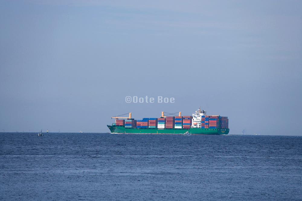 a large container ship traveling through Tokyo bay
