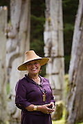 Haida guide, Elsie Stewart-Barton stands among the totems at SGang Gwaay, a UNESCO World Heritage Site in Haida Gwaii.