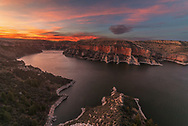 I've been to Bighorn Canyon many times, but never the northern part near Fort Smith. So I took advantage of the warm weather and paid it a visit. This area is well known for it's exceptional fishing, but there are no hiking trails. That meant I had to find my own overlook. Starting near the Okabeh Marina, I headed up a ridge, squeezed in between scratchy sagebrush, and descended to the edge of a cliff. Wind whipped across the water far below while the scattered clouds began to glow after sunset. Bighorn Lake stretches 71 miles from Montana into Wyoming and was created in 1968 after the completion of the Yellowtail Dam. As beautiful as it is now, I can't help wondering what the canyon looked like before it was flooded.