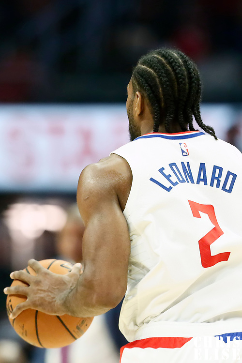 LOS ANGELES, CA - OCT 28: Kawhi Leonard (2) of the LA Clippers brings the ball up court during a game on October 28, 2019 at the Staples Center, in Los Angeles, California.