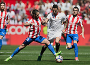 Vitolo of Sevilla FC and Lillo of Sporting Gijon during the Spanish championship Liga football match between Sevilla FC and Sporting Gijon on April 2, 2017 at Sanchez Pizjuan stadium in Sevilla, Spain - photo Cristobal Duenas / Spain / ProSportsImages / DPPI