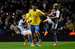 Arsenal Midfielder Mesut Ozil (GER) is challenged by Aston Villa Midfielder Fabian Delph (ENG) during the first half of the match - Photo mandatory by-line: Rogan Thomson/JMP - Tel: Mobile: 07966 386802 - 13/01/2014 - SPORT - FOOTBALL - Villa Park, Birmingham - Aston Villa v Arsenal  - Barclays Premier League.