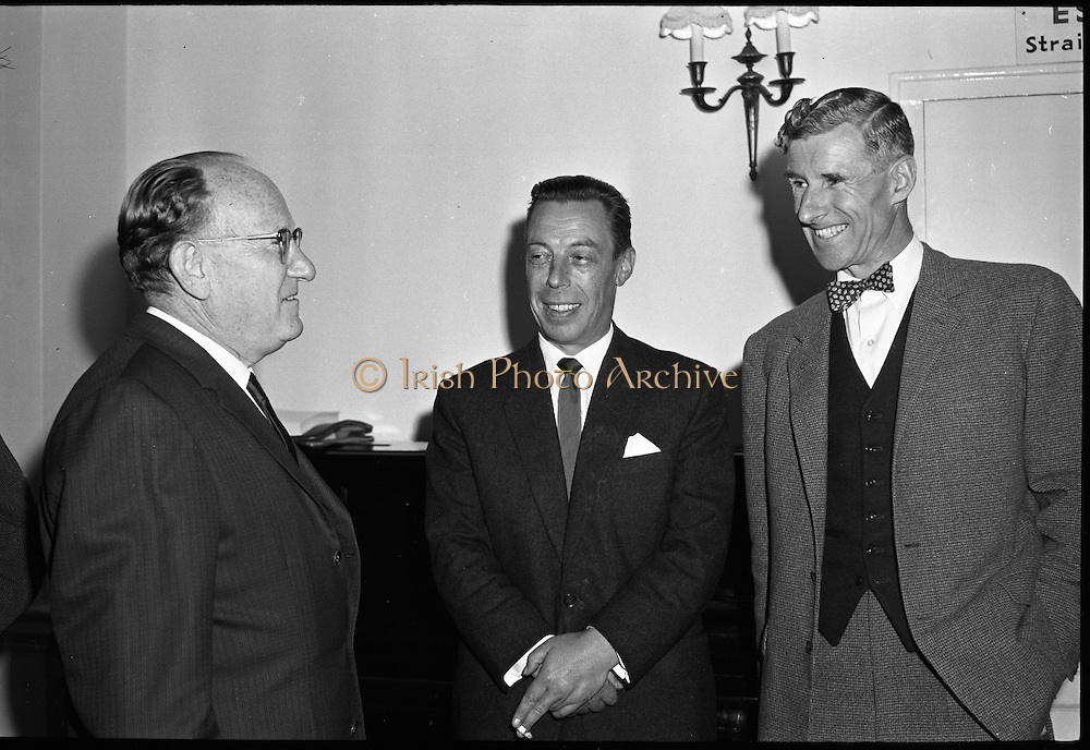 "Dr. Dichter Lecture at the Shelbourne Hotel..1961..02.10.1961..10.02.1961..2nd October 1961..Ernest Dichter is an Austrian-American psychologist and marketing expert known as the ""father of motivational research. He was invited by P Owen Ltd to give a lecture on his methods at the Shelbourne Hotel, Dublin...Picture shows Dr Dichter (left) discussing his lecture with some of his audience after his presentation."