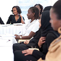"Participants of the Fall 2011 Network of Young Women Leaders (NoYWL) ""Answer the Call to Lead"" training watch a guest speaker with great interest."