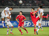 Luis Cardozo, left, and Roque Santa Cruz, right, of Paraguay challenge Ren Hang, center, and Feng Xiaoting, second right, of China during a friendly football match against China in Changsha city, central China's Hunan province, 14 October 2014.<br /> <br /> Paraguay's dismal run of form continued as they suffered a 2-1 friendly defeat to China on Tuesday (14 October 2014). The South American nation, who came into the game having won two of their previous 13 fixtures, fell short in their bid to pull off a late comeback at Changsha's Helong Stadium. In contrast to their opponents, China have now lost just two of their last 16 matches as they continue to build towards next year's AFC Asian Cup in Australia.