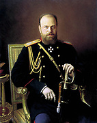 Alexander III (1845-1894), Tsar of Russia from 1881.  Portrait c1886 by Ivan Kramskoi (1837-1887) Russian painter. Three-quarter image of  Alexander in military uniform, hand on sword, seated looking forward.
