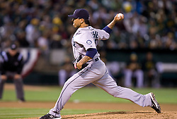 April 5, 2010; Oakland, CA, USA;  Seattle Mariners relief pitcher Brandon League (43) pitches against the Oakland Athletics during the eighth inning at Oakland-Alameda County Coliseum. Seattle defeated Oakland 5-3.