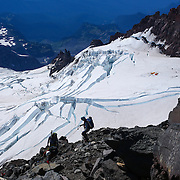 Climbers descend the unstable and dangerous Disappointment Cleaver high above the Ingraham Glacier during a summit of Mount Rainier on June 30, 2015. The iconic Pacific Northwest volcano is a popular challenge for mountaineers.  (Joshua Trujillo, seattlepi.com)