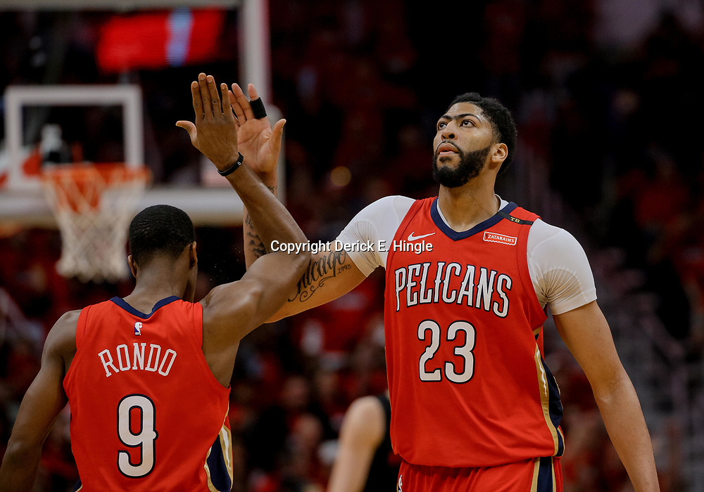 Apr 19, 2018; New Orleans, LA, USA; New Orleans Pelicans forward Anthony Davis (23) and guard Rajon Rondo (9) celebrate during the second half in game three of the first round of the 2018 NBA Playoffs against the Portland Trail Blazers at the Smoothie King Center. The Pelicans defeated the Trail Blazers 119-102.  Mandatory Credit: Derick E. Hingle-USA TODAY Sports