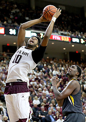 Texas A&M's Tonny Trocha-Morelos (10) grabs a rebound over Missouri's Russell Woods (25) during the second half an NCAA college basketball game, Saturday, Jan. 23, 2016, in College Station, Texas.  Texas A&M won 66-53.  (AP Photo/Sam Craft)