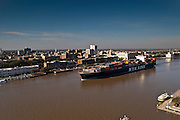 A NYK Line container ship sails past Historic River Street from the Gardens City terminal at the  Georgia Ports Authority Port of Savannah, Thursday, Feb, 20, 2014, in Savannah, Ga.  (GPA Photo/Stephen B. Morton)