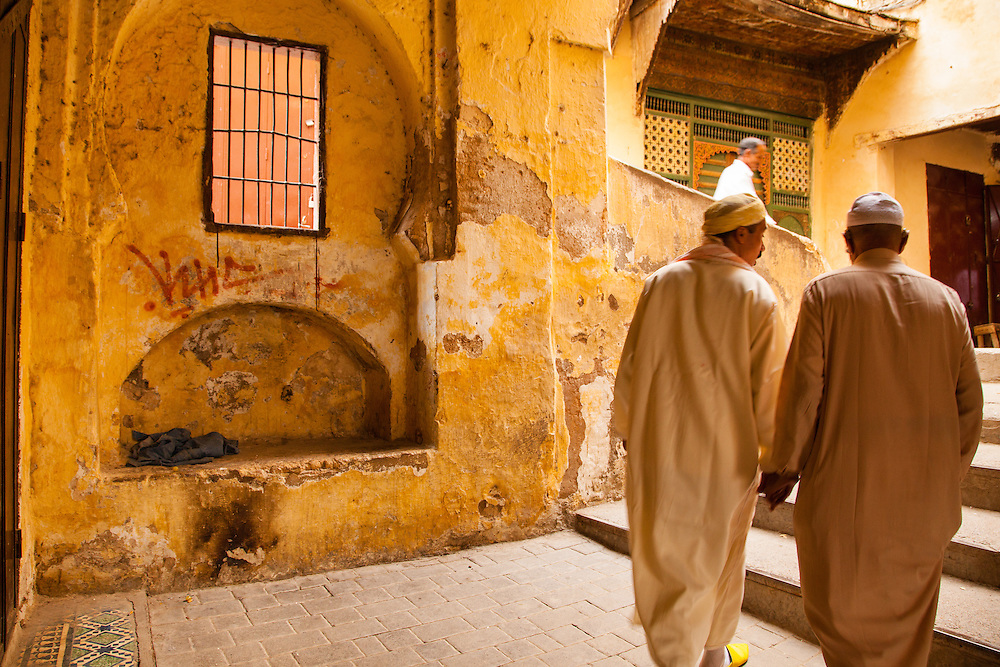 Two men walk together, Fez, Morocco.
