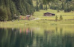THEMENBILD - die Almlandschaft und Hütten spiegeln sich im Bergsee. Der Hintersee ist ein kleiner Gebirgssee in 1313 m Höhe im Talschluss des Felbertals in Mittersill. Der Bergsee ist ein Naturdenkmal und wurde unter Schutz gestellt. Der Hintersee gilt als Geheimtipp, Erholungsgebiet und ein Platz, den man gesehen haben muss, aufgenommen am 23. Juni 2019, am Hintersee in Mittersill, Österreich // the alpine landscape and huts are reflected in the mountain lake. Hintersee is a small mountain lake 1313 m above sea level at the end of the Felbertal valley in Mittersill. The mountain lake is a natural monument and was placed under protection. The Hintersee is an insider tip, a place you must have seen and a recreation area on 2019/06/23, Hintersee in Mittersill, Austria. EXPA Pictures © 2019, PhotoCredit: EXPA/ Stefanie Oberhauser