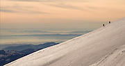 Sunset on the slopes of Mt St Helens during a backcountry ski tour