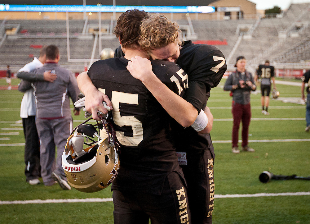 Lone Peak's David Jensen (7) and Baron Gajkowski (15) console each other in the Utah State High School 5A Football semifinal between Lone Peak and Jordan in Rice-Eccles Stadium, Thursday, Nov. 8, 2012.