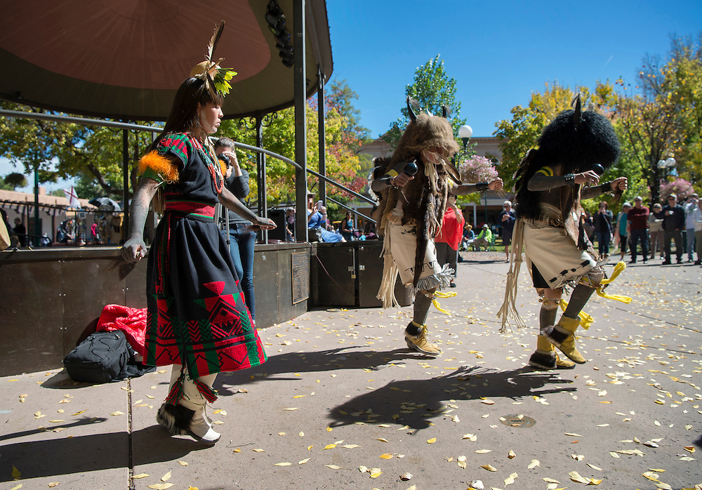 em101016f/metro/From left, Franki Maestas-Chavez, Qootsvenma Denipah-Cook and Lauren Maestas-Chavez, from Ohkay Owingeh Peublo, perform the summer buffalo dance during the first Indigenous Peoples Day on the Plaza in Santa Fe, Monday October 10, 2016. Santa Fe Mayor Javier Gonzales, with Gov. James Mountain from San Illdefonso Pueblo, opened the ceremony that included dances by 4 groups. (Eddie Moore/Albuquerque Journal)