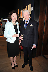 SIR CHRISTOPHER & LADY LEVER at an auction and priavte view of paintings, drawings, stories and doodles by well known personalities held at Christie's, St.James's, London on 20th September 2010.