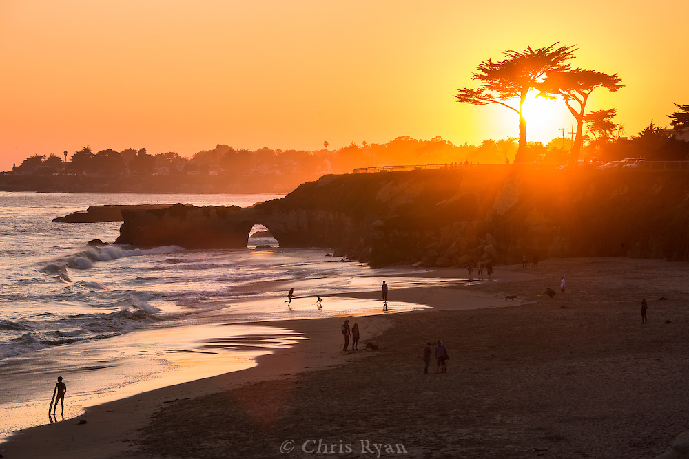 Kids playing on Its Beach at sunset, Santa Cruz, California