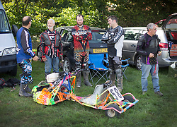 © Licensed to London News Pictures. 24/09/2016. Five Oaks, UK. Competitors wait for the first race at the Lawn Mower Racing World Championships. A weekend long set of races will see a World Champion announced on Sunday. Photo credit: Peter Macdiarmid/LNP