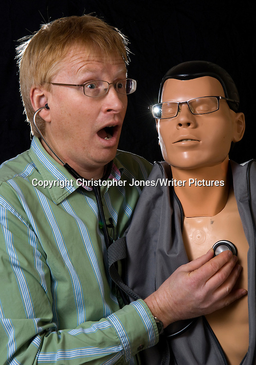 Dr. Phil Hammond with his resuscitation dummy used for his comedy stage show <br /> 7th January 2011<br /> <br /> Photograph by Christopher Jones/Writer Pictures<br /> <br /> WORLD RIGHTS