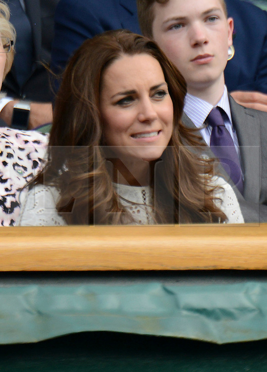 © Licensed to London News Pictures. 2/07/2014. London, UK .  HRH The Duke & HRH The Duchess of Cambridge, Prince William and Kate watch Andy Murray on the Cenre Court  on Day 9 of the Wimbledon Tennis Championships 2014. Photo credit : Mike King/LNP
