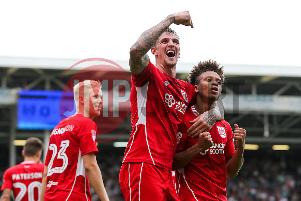 Bobby Reid of Bristol City celebrates with Aden Flint after scoring a goal to make it 0-3 - Rogan Thomson/JMP - 24/09/2016 - FOOTBALL - Craven Cottage Stadium - London, England - Fulham v Bristol City - Sky Bet EFL Championship.