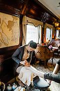 Masseuse giving foot massage on the Eastern & Oriental Train