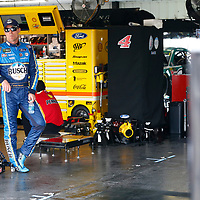 Kevin Harvick (4) hangs out in the garage during practice for the Pocono 400 at Pocono Raceway in Long Pond, Pennsylvania.