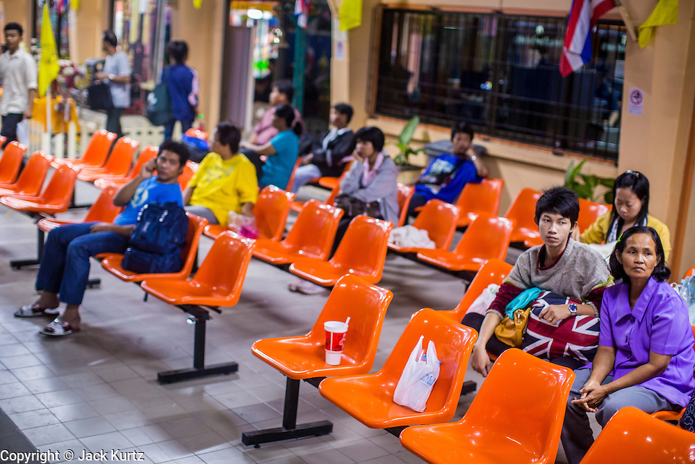 07 JANUARY 2013 - KANCHANABURI, THAILAND:  Passengers wait to board a train on the line between Bangkok (Thonburi station) and Kanchanaburi. Thailand has a very advanced rail system and trains reach all parts of the country.    PHOTO BY JACK KURTZ