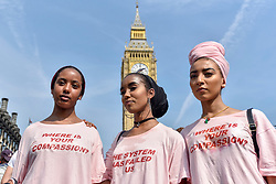"""© Licensed to London News Pictures. 21/06/2017. London, UK. Protesters stage a demonstration in Parliament Square after the Queen's Speech on a so called """"Day of Rage"""".   Many were demanding justice for the victims of the Grenfell Tower fire whilst others were supporting Jeremy Corbyn and the Labour party.. Photo credit : Stephen Chung/LNP"""