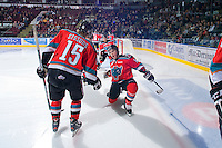 KELOWNA, CANADA, OCTOBER 20: Carter Rigby #11 of the Kelowna Rockets takes part in a pre-game ritual as  the Vancouver Giants visited the Kelowna Rockets on October 20, 2011 at Prospera Place in Kelowna, British Columbia, Canada (Photo by Marissa Baecker/shootthebreeze.ca) *** Local Caption *** Carter Rigby;